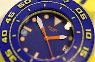 A Swatch Scuba Playero wrist watch is displayed in a shop in Zurich July 23, 2013. REUTERS/Arnd Wiegmann