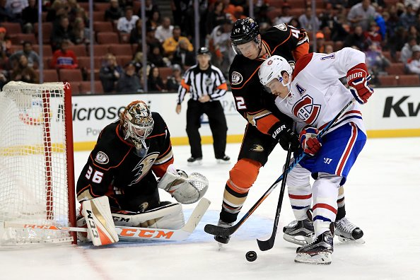 ANAHEIM, CA - NOVEMBER 29: John Gibson #36, and Josh Manson #42 of the Anaheim Ducks defend against a shot on goal by Brendan Gallagher #11 of the Montreal Canadiens during the second period of a game at Honda Center on November 29, 2016 in Anaheim, California. (Photo by Sean M. Haffey/Getty Images)