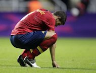Spain's Alvaro Dominguez reacts after losing 1-0 to Honduras during the London 2012 Olympic Games men's football match Hondurtas against Spain at St James' Park in Newcastle upon Tyne