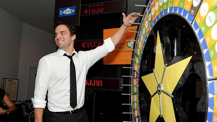 "Jake Johnson of ""New Girl"" spins the wheel for charity at the 2011 Fox Fall Eco-Casino Party at The BookBindery on September 12, 2011 in Culver City, California."