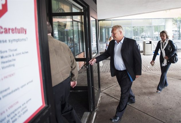 Doug Ford arrives at the Humber River Hospital where Rob Ford is undergoing tests (Canadian Press)