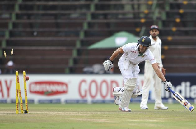South Africa's Du Plessis races to take a run as the wickets are broken in an attempt to run him out during the final day of their test cricket match against India in Johannesburg