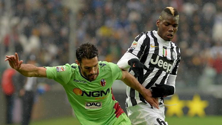 Juventus midfielder Paul Pogba, of France, right, challenges Bologna defender Nicol Cherubin during a Serie A soccer match between Juventus and Bologna at the Juventus stadium, in Turin, Italy, Saturday, April 19, 2014