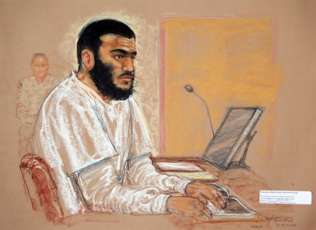 Canadian defendant Omar Khadr sits during a hearing at the U.S. Military Commissions court for war crimes, at the U.S. Naval Base, in Guantanamo Bay, Cuba, Jan. 19, 2009. The federal government is planning to seek an emergency stay of an Alberta judge's decision to grant former Guantanamo Bay prisoner Omar Khadr bail, The Canadian Press has learned. THE CANADIAN PRESS/AP, Janet Hamlin, Pool