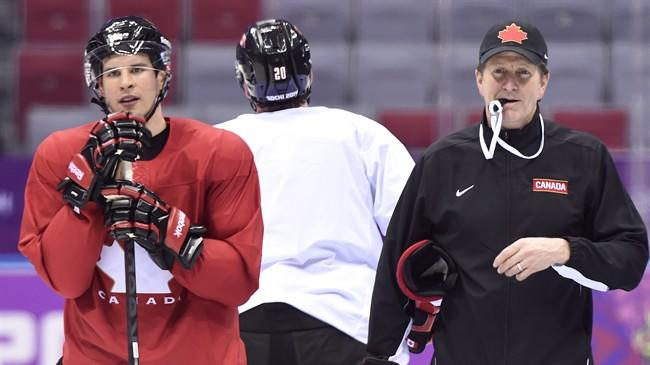Team Canada captain Sidney Crosby, left, and head coach Mike Babcock, right, watch a drill in their first men's hockey practice during the 2014 Sochi Winter Olympics in Sochi, Russia on Monday, February 10, 2014. THE CANADIAN PRESS/Nathan Denette