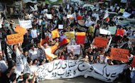 Pakistani Muslim demonstrators shout anti-US slogans during a protest against an anti-Islam film in Karachi. Ihe US embassy in Islamabad has edited and produced a 30-second TV advertisement broadcast across seven networks in Pakistan in a bid to dissociate the US government from the inflammatory movie