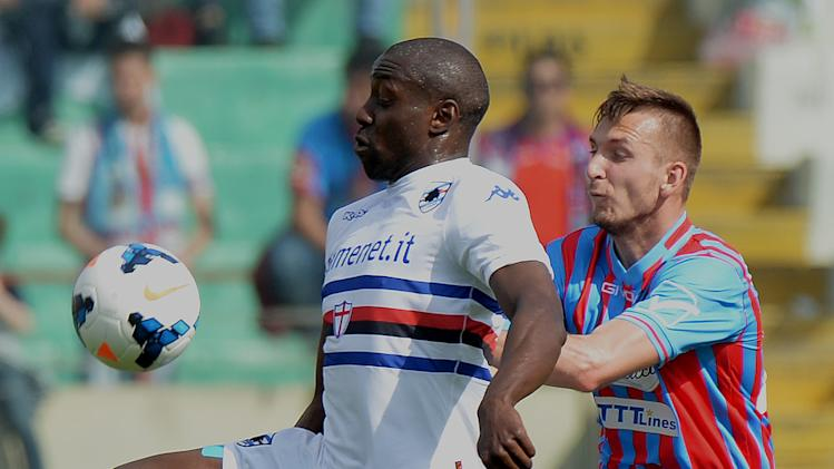Sampdoria forward Stefano Okaka, left, is challenged by Catania defender Norbert Gyomber, of Slovakia, during the Serie A soccer match between Catania and Sampdoria at the Angelo Massimino stadium in Catania, Italy, Saturday, April 19, 2014