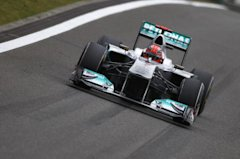 File photo of Mercedes' Schumacher driving during the qualifying session of the Chinese F1 Grand Prix at Shanghai International circuit