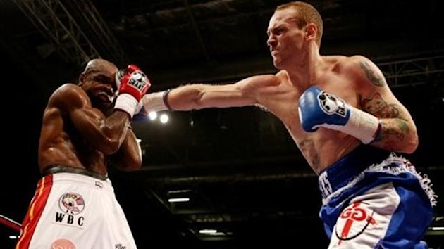 George Groves hits Glengoffe Johnson at London's ExCeL (photo: Scott Heavey)