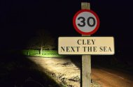 A road sign is seen for the village of Cley in Norfolk, eastern England January 8, 2014. REUTERS/Toby Melville