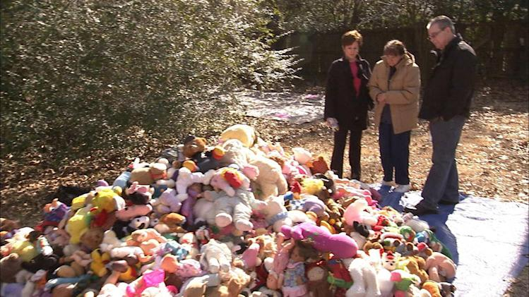 "Geralin Phyllis and Dr. Pfeffer look at the mound of dolls gathered outside in season premiere of ""Hoarders."""