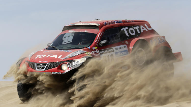 France's Christian Lavieille and co-pilot Jean-Michel Polato compete with their Proto Dessoude during the first stage of the Dakar Rally 2013, from Lima to Pisco
