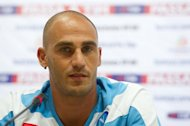 Paolo Cannavaro of SSC Napoli attends a press conference in Beijing on August 9, 2012. Italian football federation (FIGC) officials on Thursday overturned sanctions handed to Napoli which saw the Serie A title-chasers deducted two points