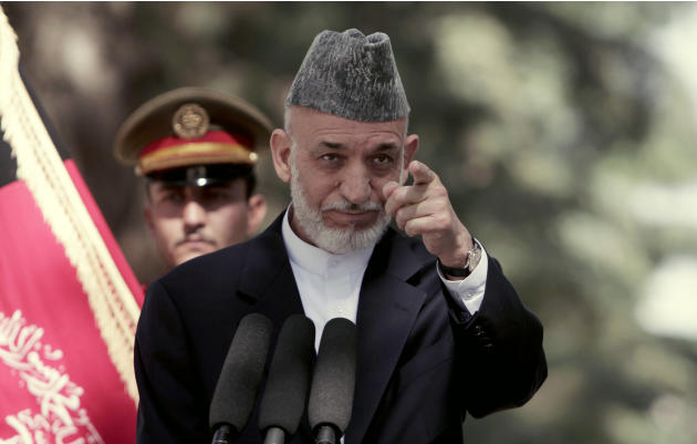 Afghan President Hamid Karzai takes a question during a press conference at the presidential palace in Kabul, Afghanistan, Monday, Oct. 7, 2013. Karzai says disagreements over security and sovereignty