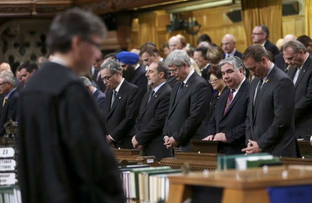 Members of Parliament have a moment of silence in the House of Commons in Ottawa October 23, 2014