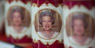 Souvenir mugs commemorating Queen Elizabeth II's diamond jubilee are displayed in a shop in London on May 17. Retailers have gone into overdrive for the anniversary, cramming displays with items inspired by the queen's 60-year reign