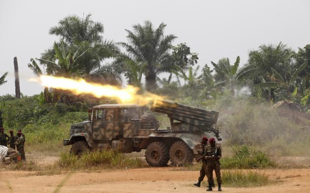 Congolese soldiers launch missiles during their military operation against ADF-NALU rebels outside the town of Beni