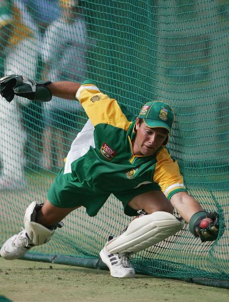 JOHANNESBURG, SOUTH AFRICA - JANUARY 11:  Mark Boucher of South Africa makes a diving catch during the South Africa nets session on January 11 2005 at the Wanderers Stadium,  Johannesburg, South Afric