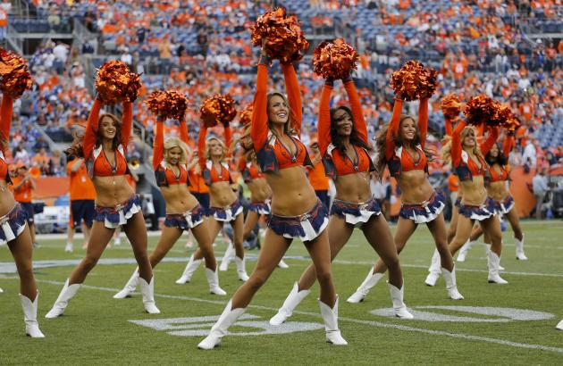 The Denver Broncos cheerleaders perform prior to an NFL football game against the Indianapolis Colts, Sunday, Sept. 7, 2014, in Denver. (AP Photo/Jack Dempsey)