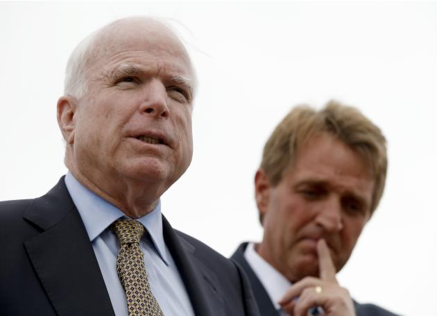 FILE - Sen. John McCain, left, R-AZ, and Sen. Jeff Flake, R-AZ, hold a news conference to discuss recent reports that dozens of VA hospital patients in Arizona may have died while awaiting medical car