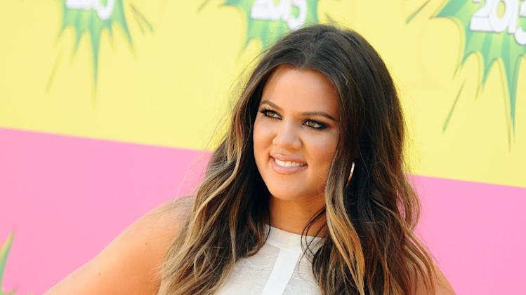 "FILE - In this March 23, 2013 file photo, Khloe Kardashian arrives at the 26th annual Nickelodeon's Kids' Choice Awards, in Los Angeles. New York Gov. Andrew Cuomo sent a letter to Khloe Kardashian's informing the reality star that the logo on her T-shirt line may be violating copyright law. Her T-shirt line resembles the logo of a New York farm program. The state's design has an image of the Statue of Liberty above crop rows, encircled by the words ""Pride of New York.""  (Photo by Jordan Strauss/Invision/AP, File)"