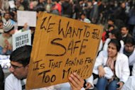 An Indian demonstrator holds a placard during a protest calling for better safety for women following the rape of a student in New Delhi on December 24, 2012. Indian Prime Minister Manmohan Singh has appealed for calm and vowed to protect women as police struggled to quell increasing outrage over sex crimes following the gang-rape of a student