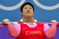 China's Zhou Lulu competes to win the gold medal during the women's 75+kg group A weightlifting event of the London 2012 Olympic Games at The Excel Centre in London. Zhou won the women's Olympic over-75kg weightlifting gold with a new world record at the ExCel Arena here on Sunday