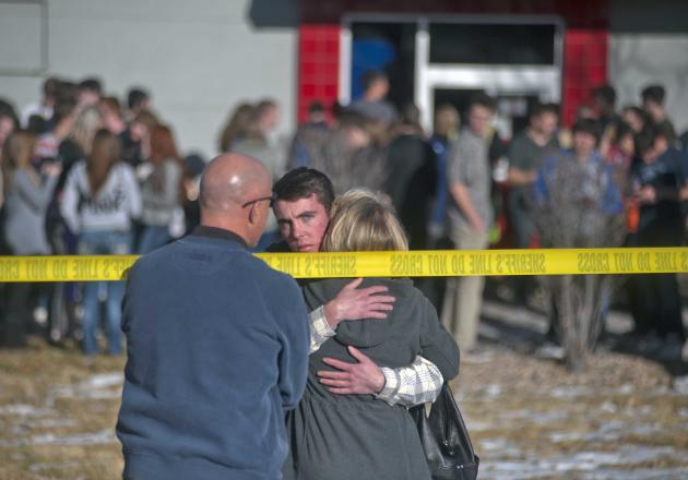 Students gather and reunite with their families at a fast food joint across from Arapahoe High School, after a student opened fire in the school in Centennial, Colorado