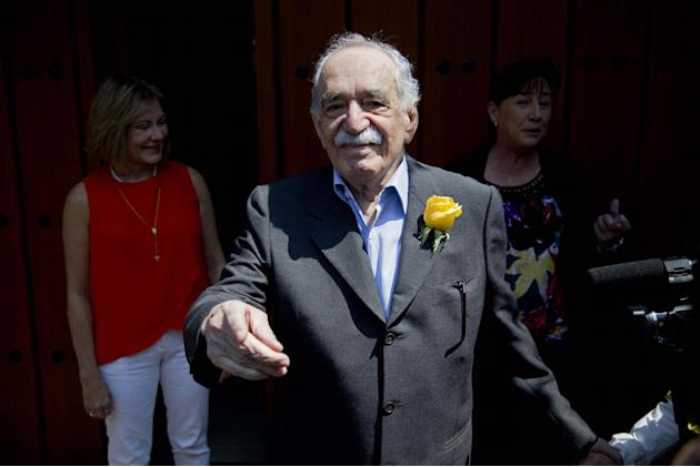 FILE - In this March 6, 2014, file photo, Colombian Nobel Literature laureate Gabriel Garcia Marquez greets fans and reporters outside his home on his birthday in Mexico City. The family of says Nobel