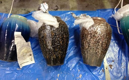 This photo, made available by the Australian Federal Police, shows packages of illegal drugs drugs concealed in terracotta pots, found and siezed from a yacht in Tonga. The yacht which washed up on a Pacific atoll with a badly decomposed body onboard was carrying more than 200 kilograms of cocaine worth as much as $120 mln, according to police.