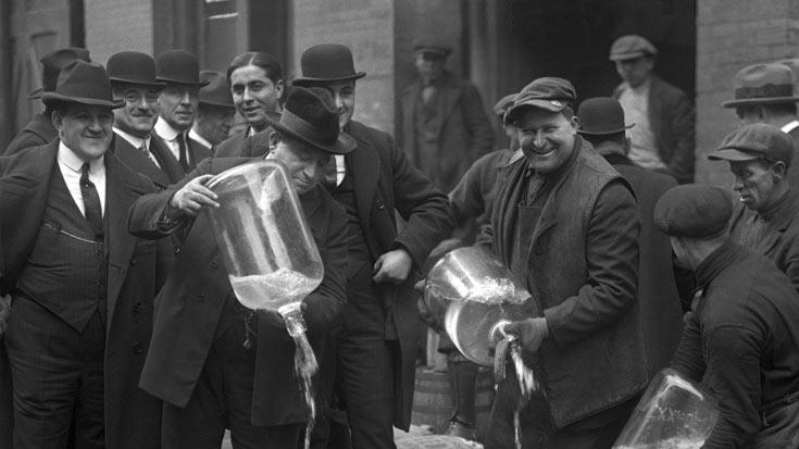 "NYC Liquor Raid Izzy Einstein Agents dumping booze liquor into gutter in 1922 as seen on ""Prohibition."""
