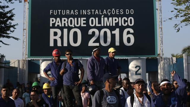 Olympic Games - Rio workers end strike but issue pay talks warning
