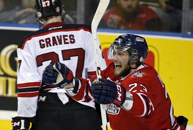 Oshawa Generals Tobias Lindberg celebrates his teammate Stephen Desrocher's game-winning goal against the Quebec Remparts during the overtime period of their Memorial Cup hockey game at the Colisee Pepsi in Quebec City, May 24, 2015. REUTERS/Mathieu Belanger
