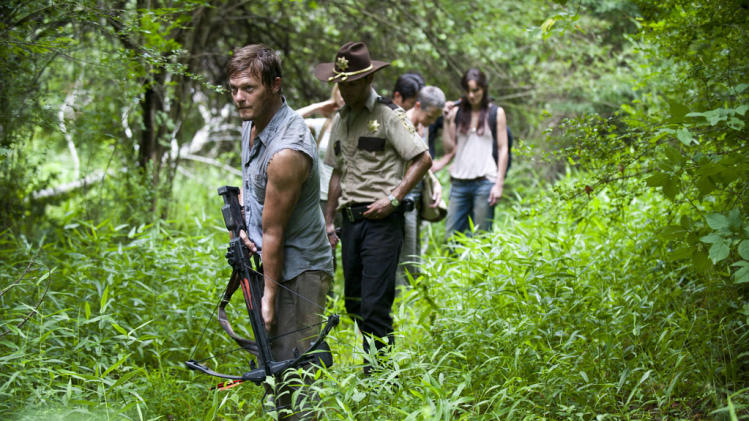"Norman Reedus as Daryl Dixon, Andrew Lincoln as Rick Grimes, Steven Yeun as Glenn, Melissa Suzanne McBride as Carol and Sarah Wayne Callies as Lori Grimes on ""The Walking Dead."""