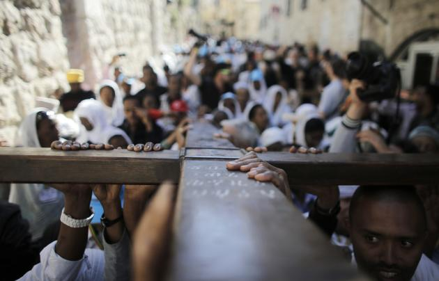 Christian worshippers carry a cross during a procession along the Via Dolorosa on Good Friday in Jerusalem's Old City