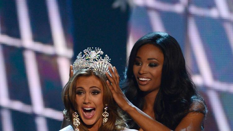 Miss Connecticut Erin Brady is crowned the winner of the Miss USA 2013 pageant by Nana Meriwether, Sunday, June 16, 2013, in Las Vegas. (AP Photo/Jeff Bottari)