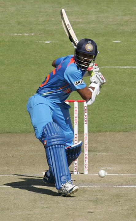 India's Shikar Dhawan bats during the first match of the five match ODI cricket series between India and hosts Zimbabwe at the Harare Sports Club on July 24, 2013. AFP/PHOTO Jekesai Njikizana.