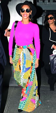 Beyonce goes neon in a Michael Kors Cashmere top and patchwork Etro skirt