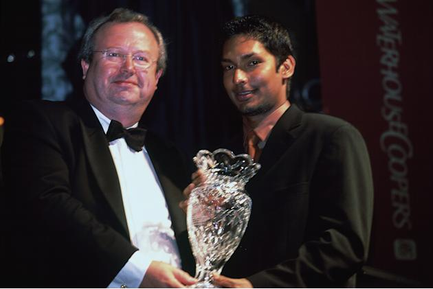 Kumar Sangakkara is presented his award by Kieran Poynter