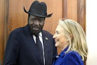 US Secretary of State Hillary Rodham Clinton (R) meets with South Sudan's President Salva Kiir at the Presidential Office Building. Clinton Friday paid tribute to a Ugandan human rights coalition working for gay rights, hours after a brief stop in Juba where she called for a compromise deal between the rival two Sudans