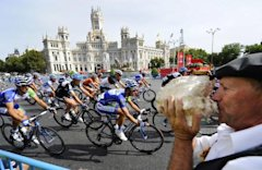 A pack of riders cycles during the 21th stage of the Tour of Spain