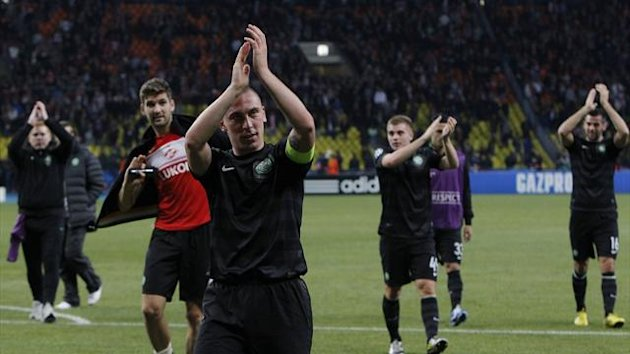 Celtic's Scott Brown (C) and teammates applaud supporters after their team's Champion's League Group G soccer match against Spartak Moscow in Moscow's Luzhniki Stadium October 2, 2012