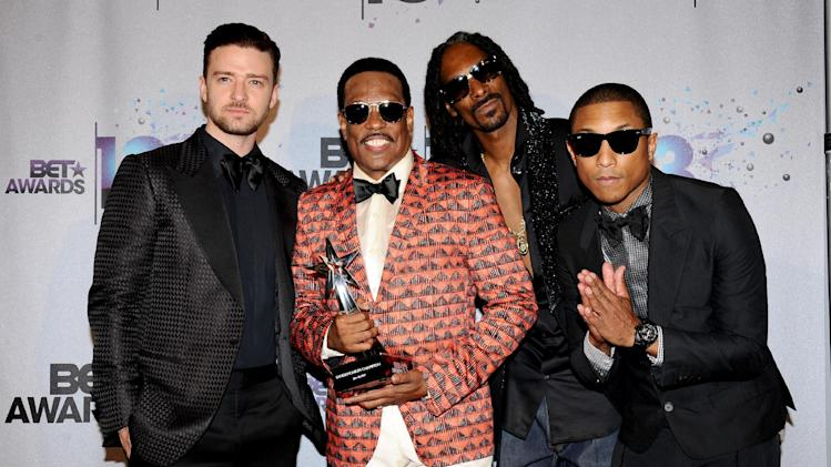 From left, Justin Timberlake, Charlie Wilson, Snoop Lion, and Pharrell Williams pose backstage at the BET Awards at the Nokia Theatre on Sunday, June 30, 2013, in Los Angeles. (Photo by Scott Kirkland/Invision/AP)