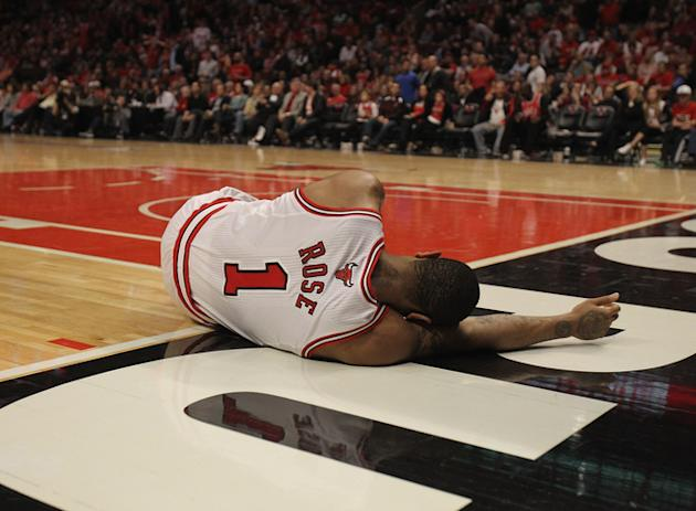 Derrick Rose #1 Of The Chicago Bulls Lays On The Floor Aftrer Suffering An Injury Against The Philadelphia 76ers In Getty Images