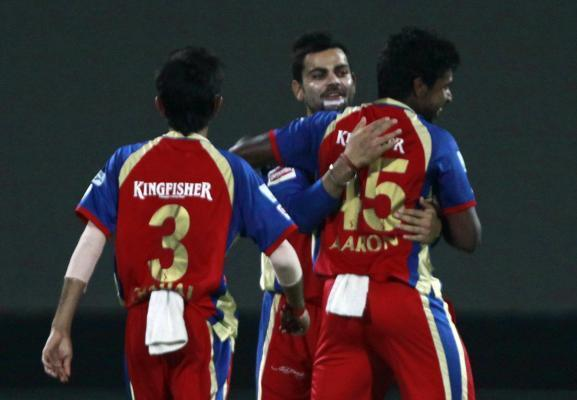 Royal Challengers Bangalore player Varun Aaron, Virat Kohli and others celebrate fall of a wicket during the 11th match of IPL 2014 between Kolkata Knight Riders and Royal Challengers Bangalore, playe