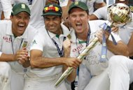 Imran Tahir (centre), Graeme Smith (right) and Jacques Rudolph celebrate with the ICC World Test Mace at Lord's in August after South Africa replaced England as the number one Test cricket side