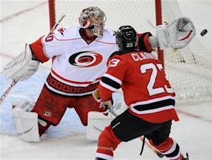 Tlusty leads Hurricanes over Devils 4-2