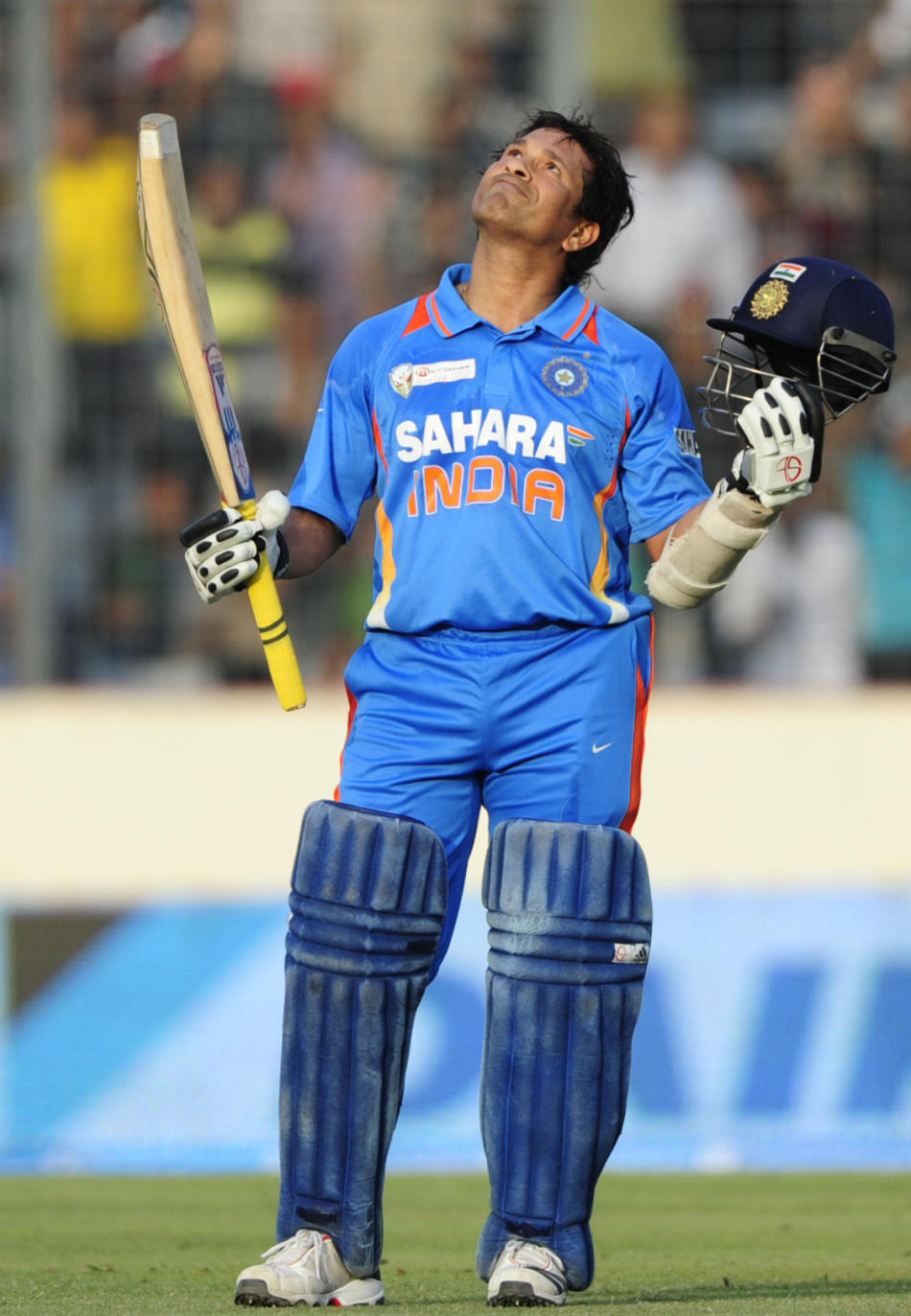 Indian batsman Sachin Tendulkar reacts after scoring his hundred century during the one day international (ODI) Asia Cup cricket match between India and Bangladesh at the Sher-e-Bangla National Cricke