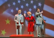 In this June 5, 2012 handout photo provided by the San Francisco Opera, Chen-Ye Yuan, as Chou En-lai, from left, Maria Kanyova, as Pat Nixon, and Brian Mulligan, as Richard Nixon, are shown during a scene from the final dress rehearsal of Nixon in China. The production, increasingly recognized as a modern masterpiece, is finally getting the recognition it deserves on the home ground of composer John Adams, in a sparkling production that highlights the San Francisco Opera's summer season. (AP Photo/San Francisco Opera, Cory Weaver, handout)