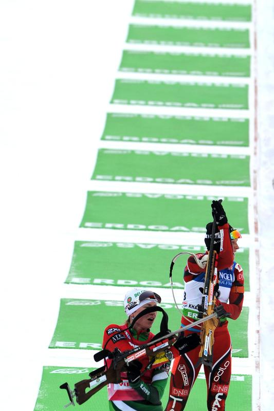 Belarus's Darya Domracheva (L) And Norway's Tora Berger (R) Compete In The Women's 12.5 Km Mass AFP/Getty Images